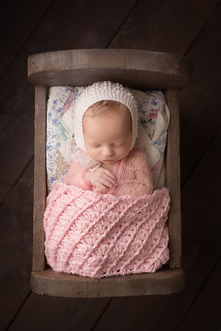 newborn-photography-studio-in-lancaster, baby girl in wood bed